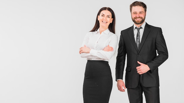 Colleagues woman and man smiling and standing together