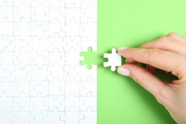 Collect puzzle hand and puzzle pieces on the table
