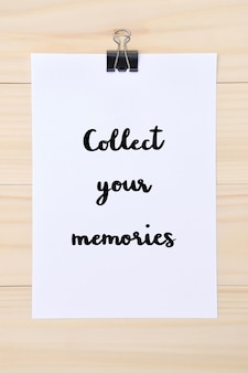 Collect your memories hand drawn lettering on white paper