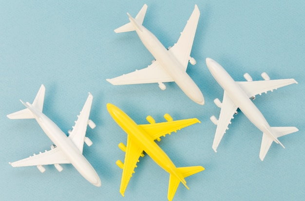 Collection of airplane toys with only a yellow one