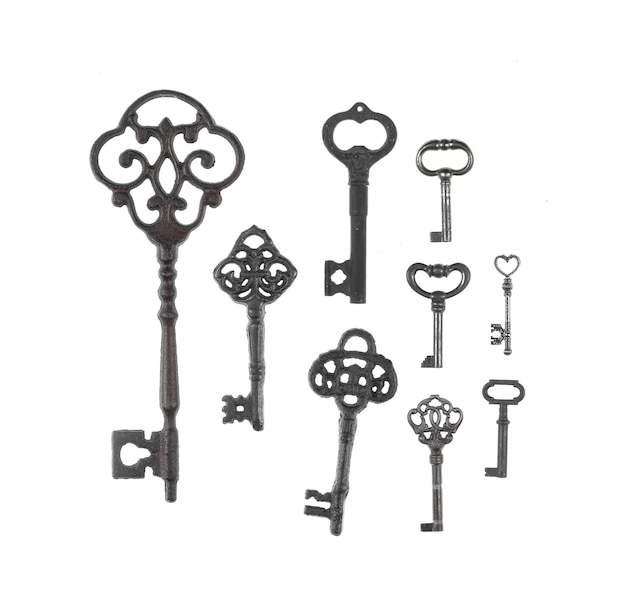 Collection of ancient rusty keys isolated on white background