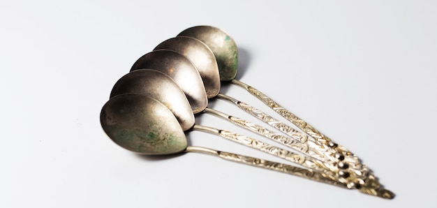 Collection of ancient spoons. on surface of white.