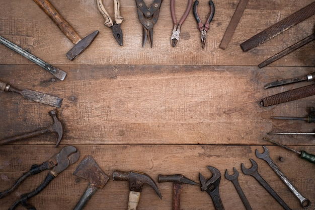 Collection of antique woodworking handtools on a rough workbench old wooden with blank copy space