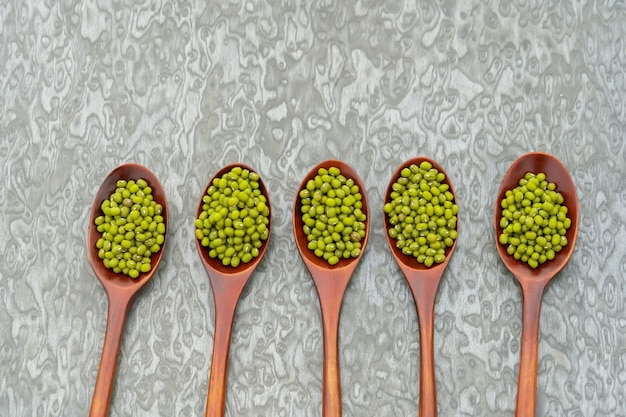 Collection of bean in wooden spoons.