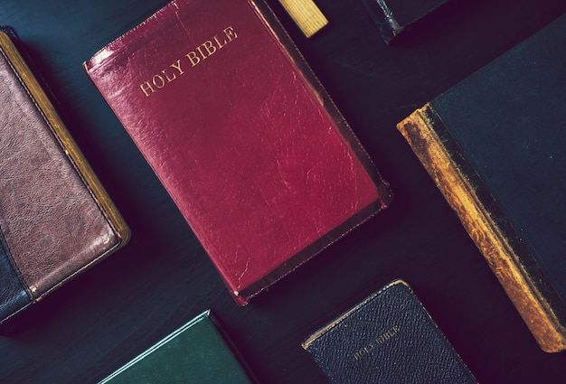 Collection of bibles on a table