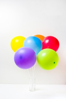 Collection of bright balloons in glass