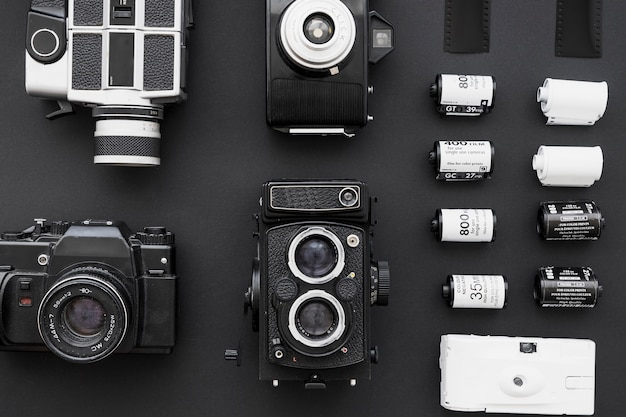 Collection of cameras near rows of film