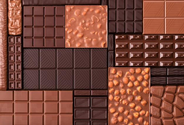 Коллекция шоколадных батончиков, вид сверху. вкусный десерт из какао-продуктов