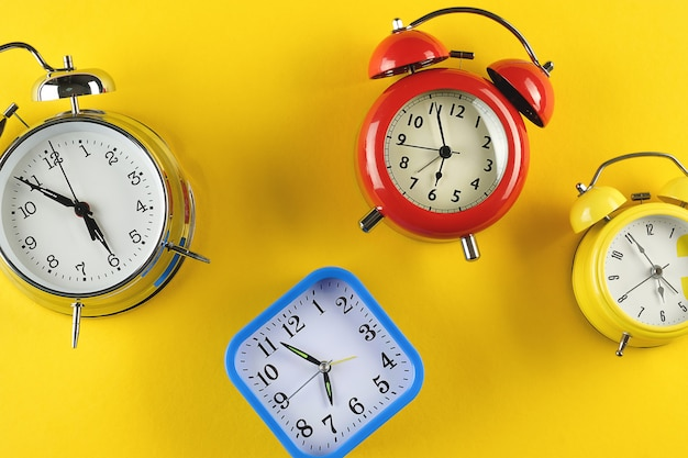 Collection of colorful alarm clocks in retro vintage style.