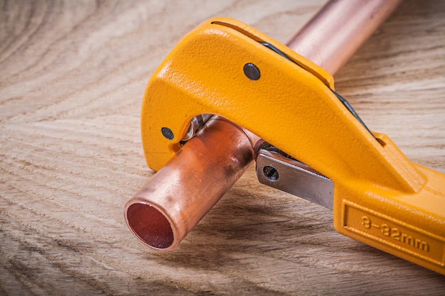 Collection of copper water pipe cutter on wooden board plumbing brassware concept