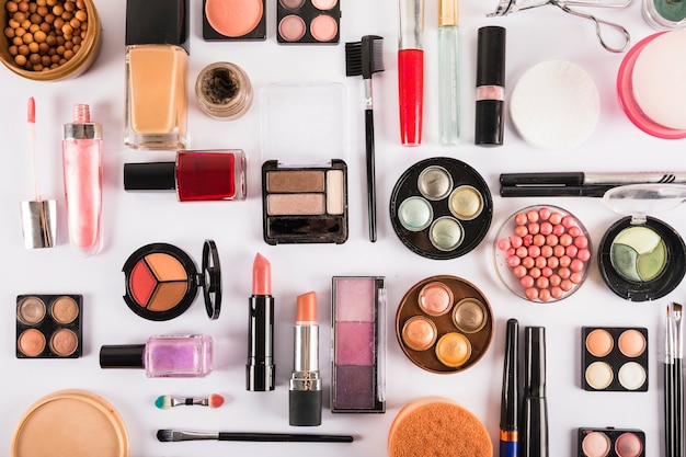 Collection of cosmetic beauty products on white backdrop