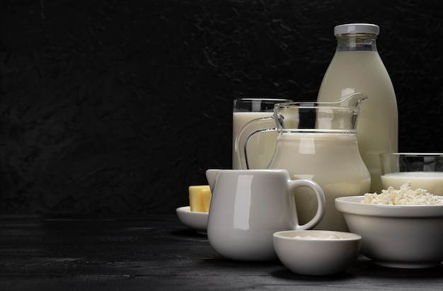 Collection of dairy products on black wooden