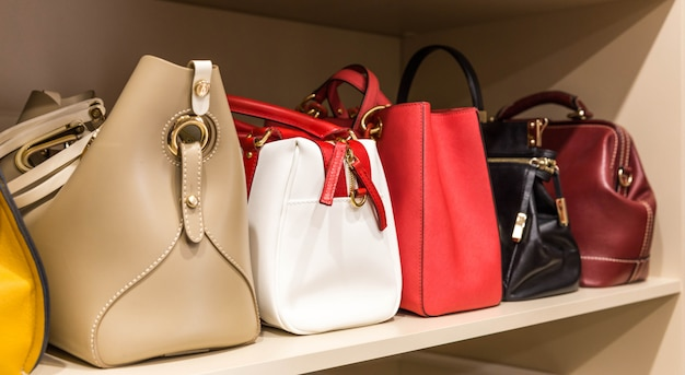 Collection of different handbags in woman closet