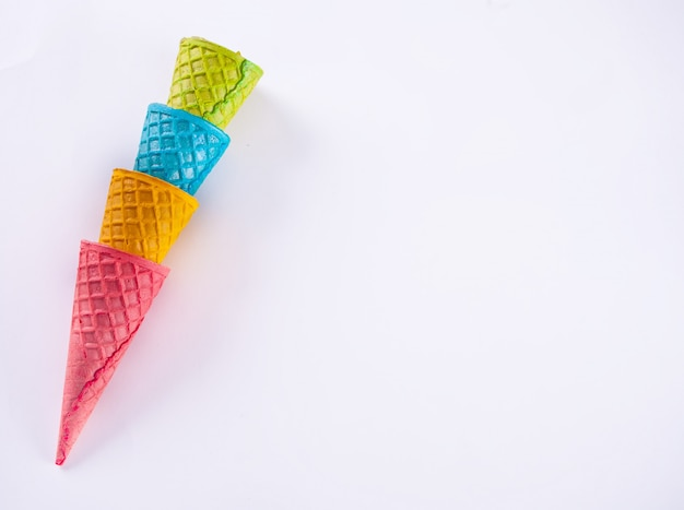 Collection of empty colorful ice cream cone on white background