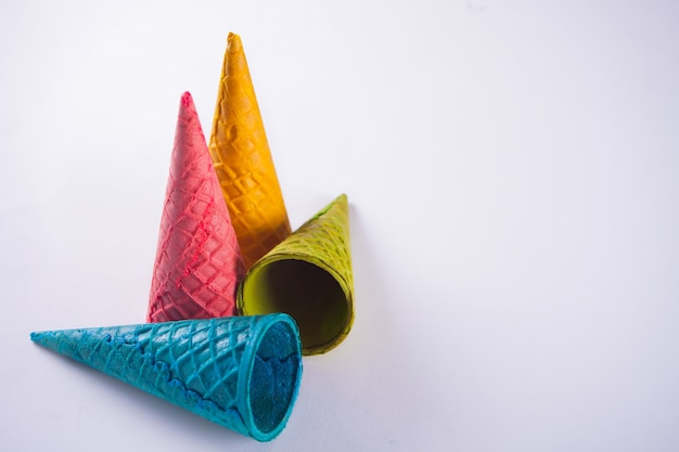 Collection of empty colorful ice cream cone on white