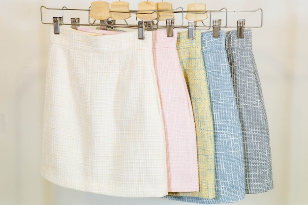 Collection of fashion skirts on the hanger. clothing store