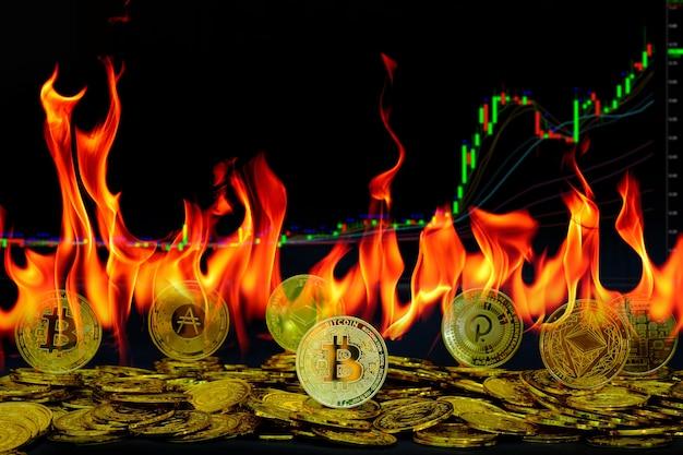 화재 불꽃 및 거래 차트 배경에서 금화 암호 화폐 수집