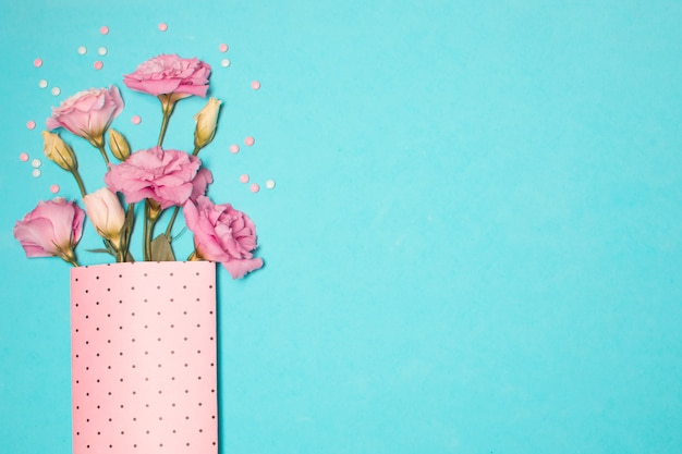 Collection of fresh beautiful flowers in paper pack