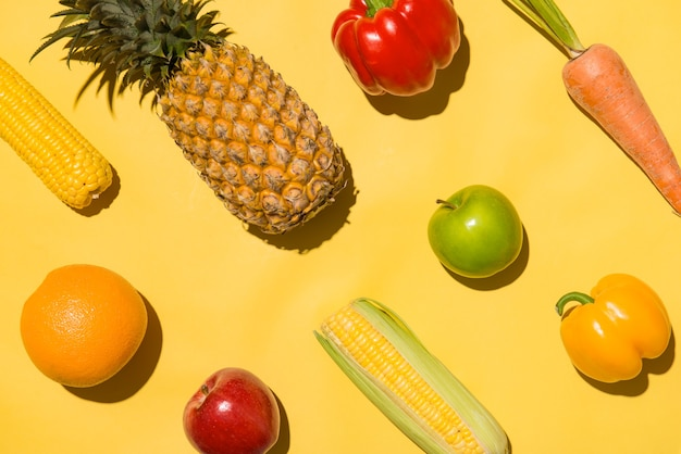 Collection of fresh fruits on yellow background.