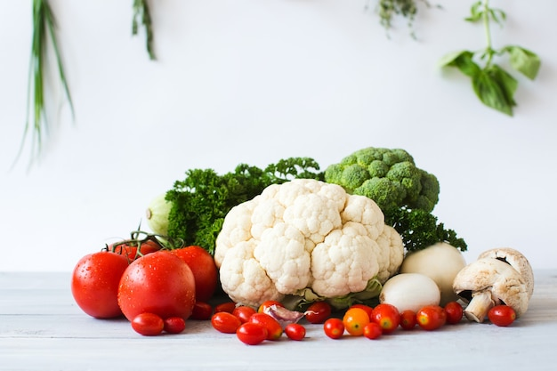 Collection of fresh vegetables on the kitchen table isolated