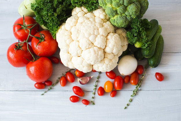 Collection of fresh vegetables on the kitchen table top view