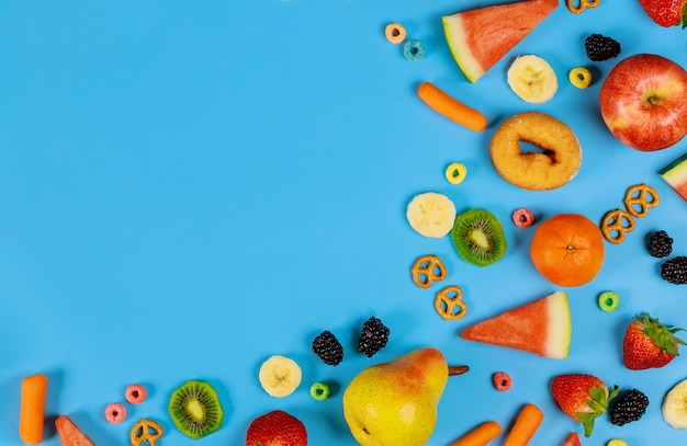 Collection of fruits and vegetables on blue surface