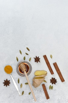 Collection of indian colorful spices and honey. turmeric, cinnamon, ginger, honey, star anise, cardamom on light background with copy space.