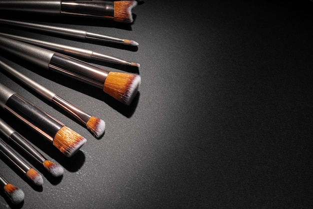 Collection of make up brushes on black