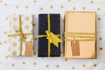 Collection of present boxes in wraps with tags