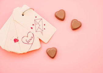 Collection of tags with different pictures near chocolate candies