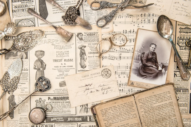 Collection of old newspapers and objects
