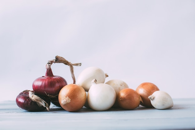 Collection of onions on a wood