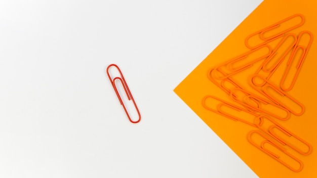 Collection of paper clips with only a red one