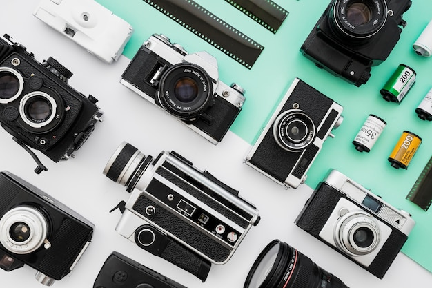 Collection of photo and video cameras near film