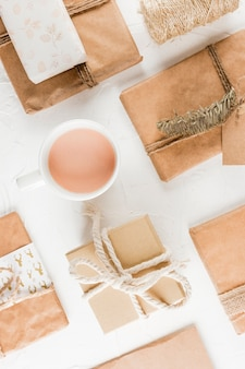 Collection of present boxes near cup with drink