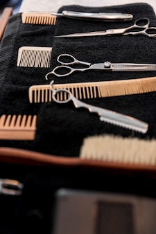 Collection of professional barber equipment on towel