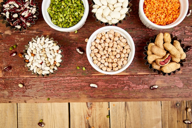 Collection set of beans and legumes. bowls of various lentils
