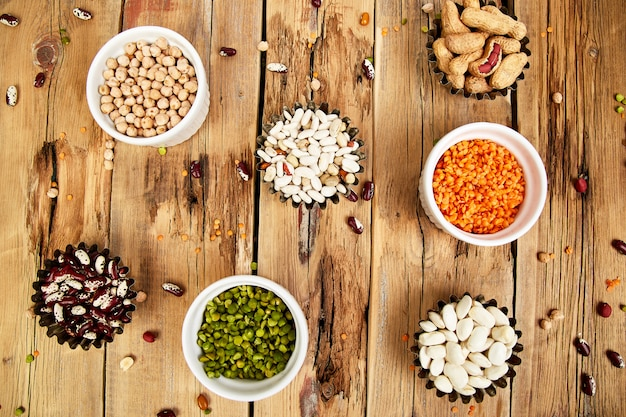 Collection set of beans and legumes. bowls of various lentils.