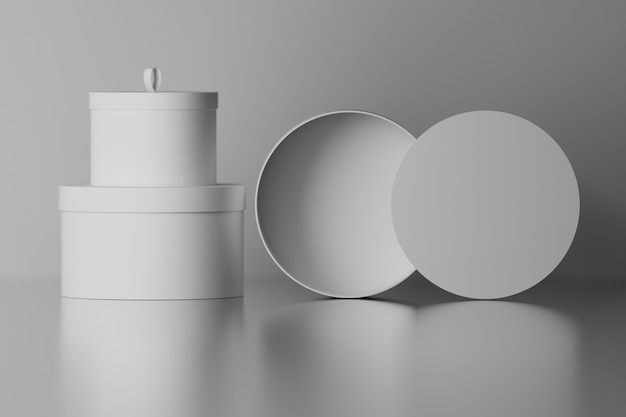 Collection set of round gift packaging boxes with blank surfaces on mirror glossy floor