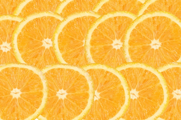 A collection of sliced citrus fruits with a neat pattern