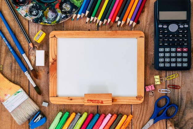 Collection supplies with back to school on wooden background.