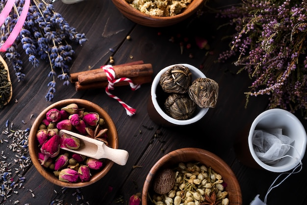 Collection of tea and natural additives in wooden