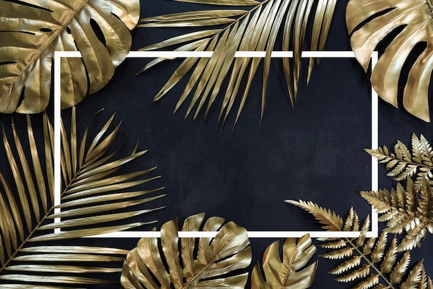 Collection of tropical leaves in gold color on black space backgroundabstract leaf decoration desig