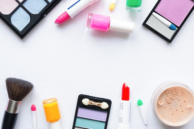 Collection of various cosmetics on white background