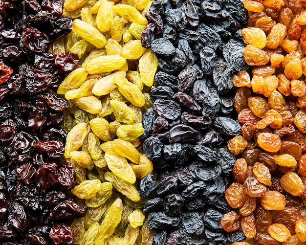 Collection of various raisins as a food surface Premium Photo