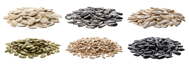 Collection of various whole and peeled seeds (sunflower, pumpkin) isolated on white background with clipping path
