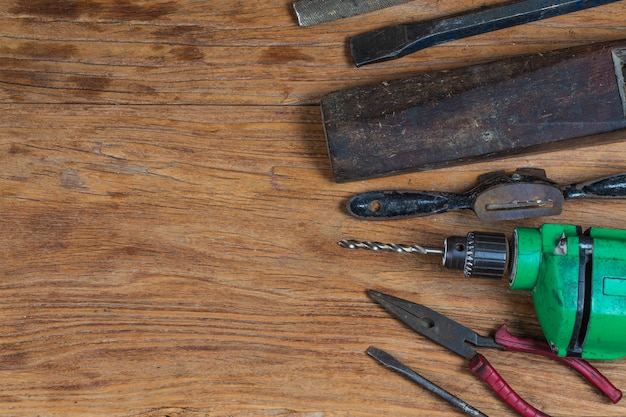 Collection of vintage woodworking tools on a rough workbench and blank copy space: carpentry, craftsmanship and handwork concept,