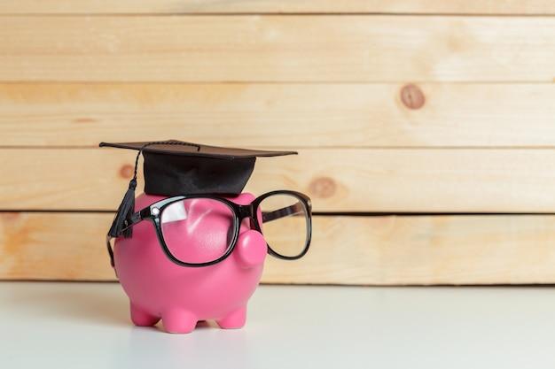 College graduate student diploma piggy bank