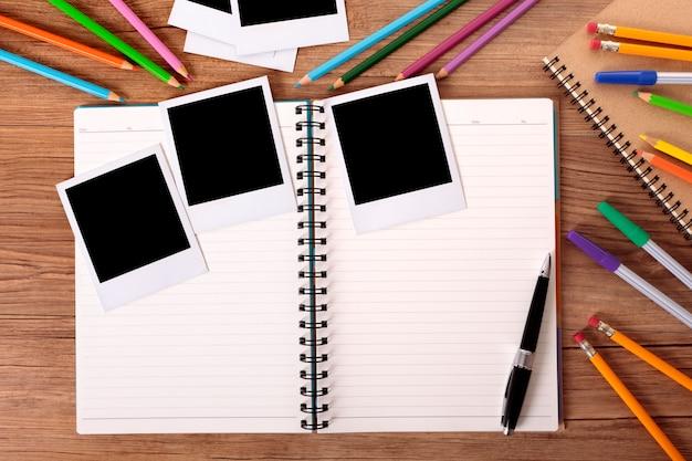 College student desk with blank photo album