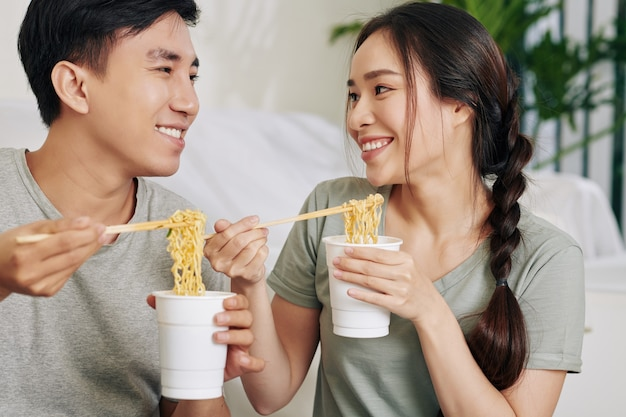 College students eating noodle